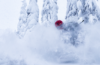 Photo of skier in deep powder.