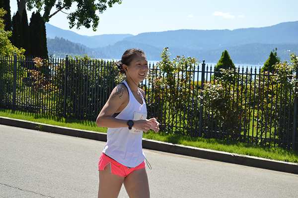 Photo of runner along the CdA lakefront.