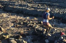 Photo of Sarah Oscarson running across Mt. St. Helens blast zone.