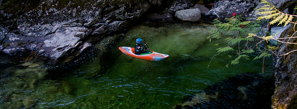 Photo of whitewater kayaker from above.