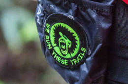 Close up photo of Trail Maniacs patch on backpack.