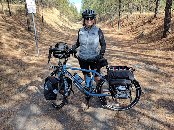 Photo of Kathy Greer and bike in Riverside State Park.