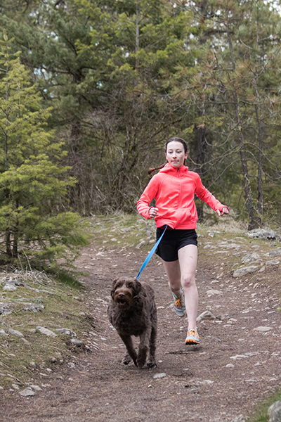 Photo of Lauren West running with dog.