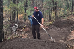 Photo of Evergreen East member completing trail maintenance.