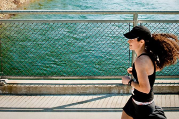 Photo of runner on bridge over the Spokane River.