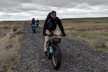 Photo of three bikerpackers on the Columbia Plateau Trail.