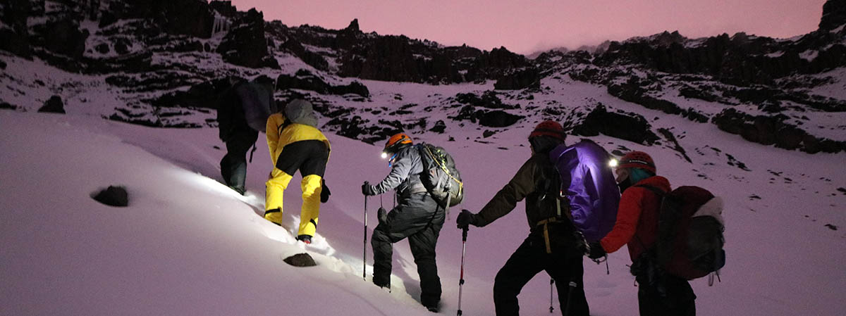 Photo of climbers kicking steps on Kilimanjaro.