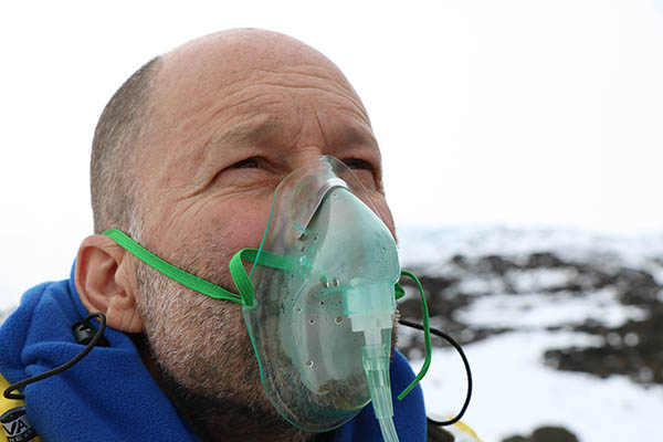 Photo of climber using oxygen.