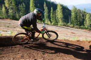 Mountain biking navigating a turn at Silver Mountain Bike Park.