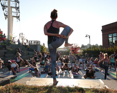 Photo of yoga instructor and crowd at Riverfront Park.