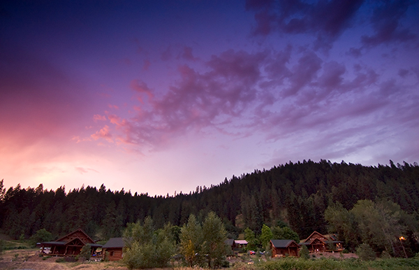 Photo of sunset over River Dance Lodge.