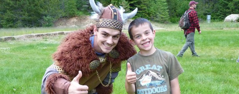 Camper is all smiles with the Biking costumed recreation leader.