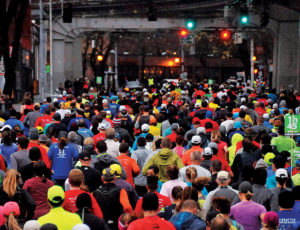 Photo of racers running under an overpass in Seattle.