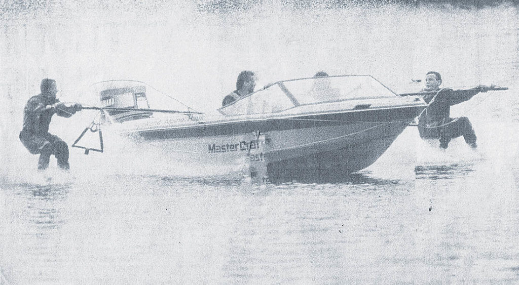 Photo of two waterskiers and boat.