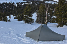 Photo of tent set up in snow on Mount Chisholm.