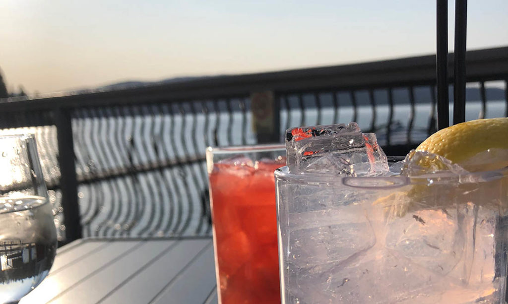 Photo of drinks on a dining table overlooking Lake Coeur d'Alene.