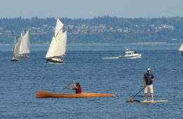 Photo of Hari Heath in his paddlecraft with boats in the background in Port Townsend Bay.