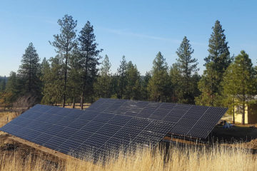 Photo of solar panels installed on the ground.