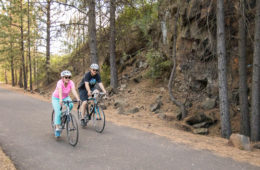 Photo of Lisa Brown and her partner biking on the Fish Lake Trail.