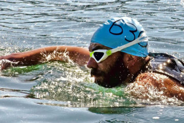 Photo of competitive swimmer during the Long Bridge Swim in Sandpoint Idaho.