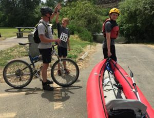 Mountain bikers and kayakers at the transition point.
