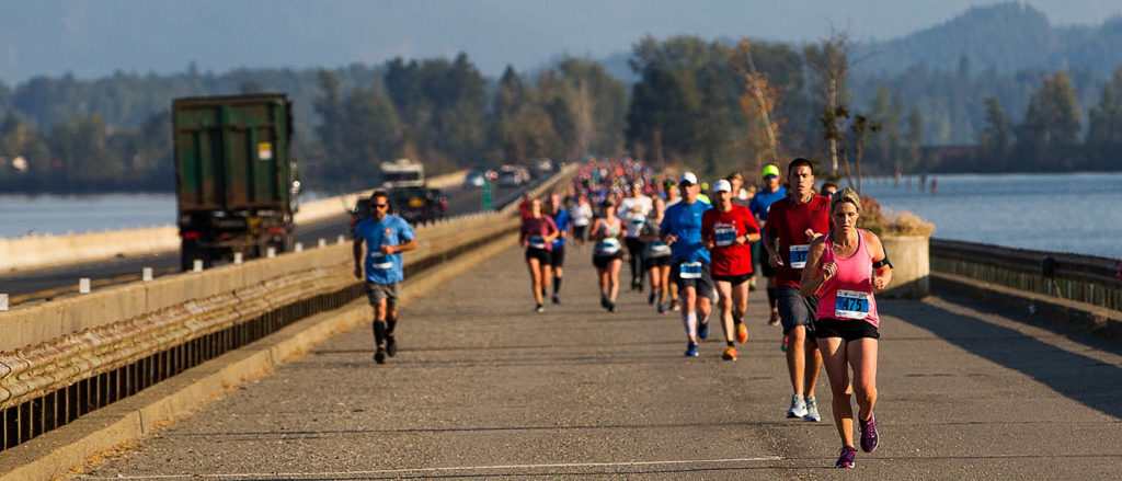 Photo of runners crossing a bridge during the Sandpoint Scenic Half.