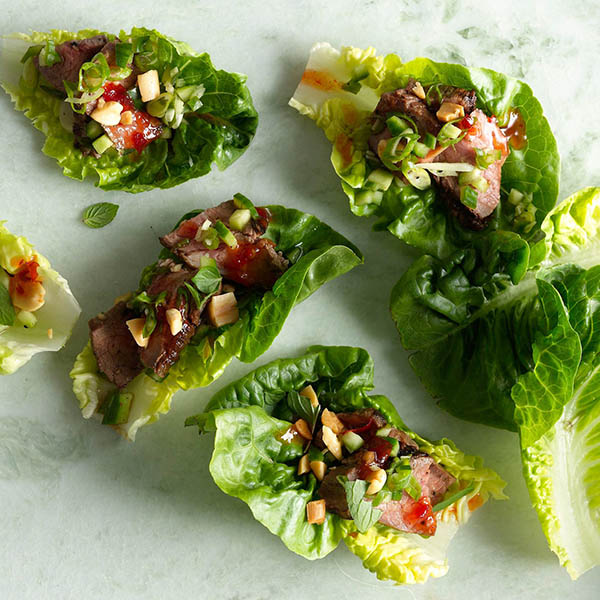Photo of lettuce cups with steak and vegetables.