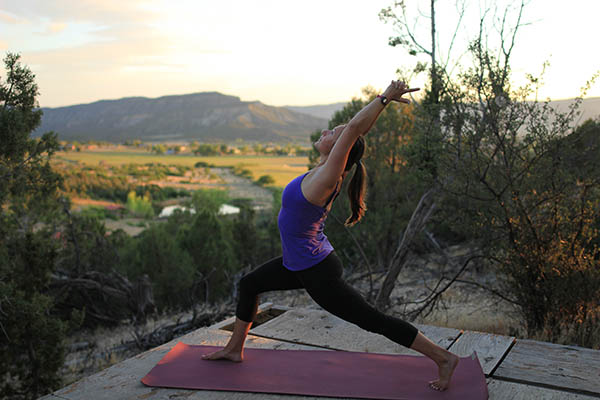 Photo of author in crescent lunge pose.