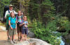 Photo of Joal Lee and his daughters posing on a rock outrcropping in Northeast Oregon's Eagle Cap Wilderness.