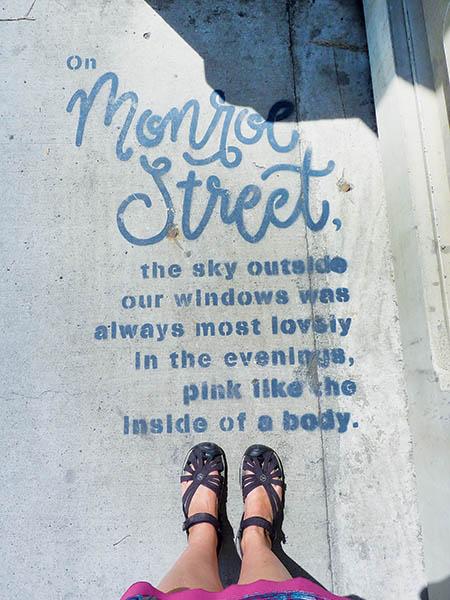 Photo looking down at poetry on the Monroe Street Bridge.