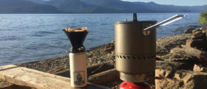 Photo of backpacking stove with pot and coffee on the shore of Pend Orielle.