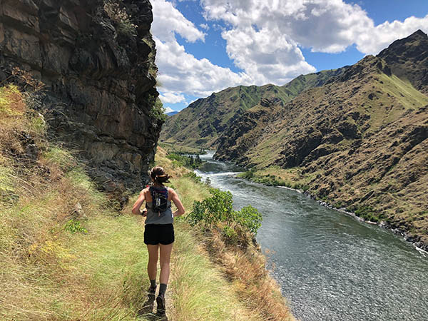 Runner on a trail above the Snake River.