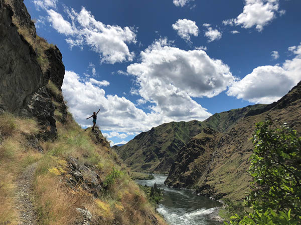 Photo of author standing on rock outcropping overlooking the Snake River.