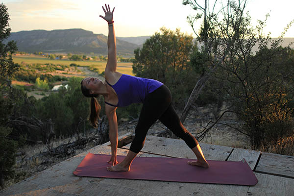 Photo of author in revolved triangle pose.