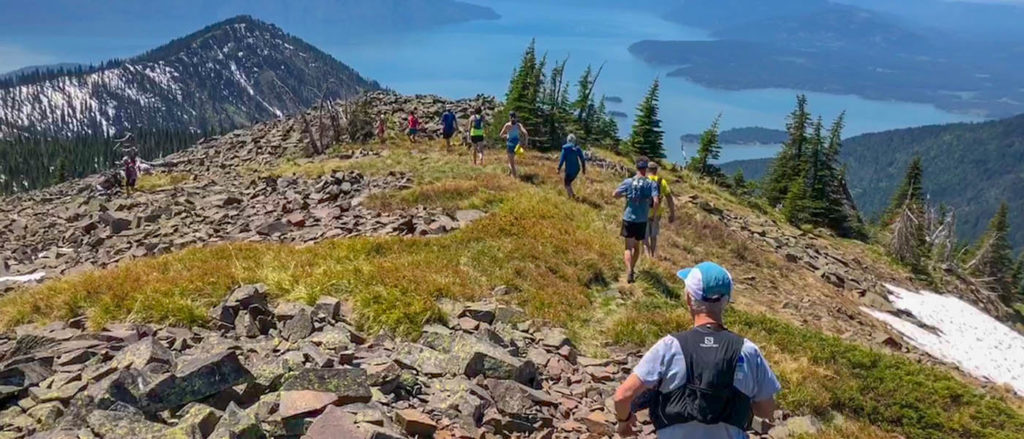 Photo of trail runners on top of Roundtop Mountain.