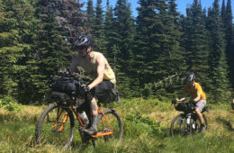 Photo of three bikers descending Chilco Mountain via single track.