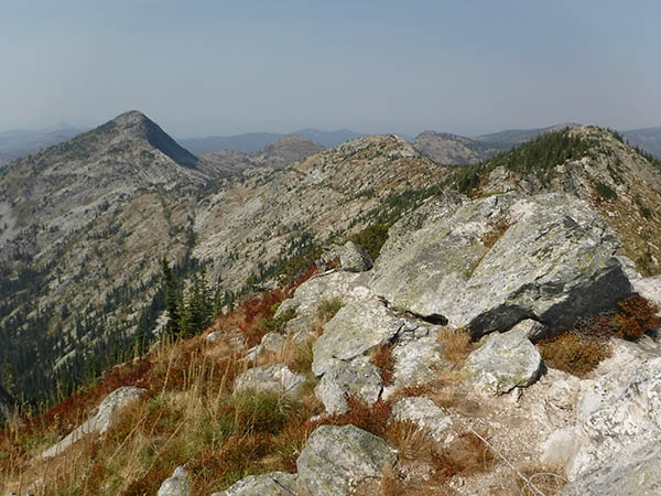 Photo of boulder field with peak in background.