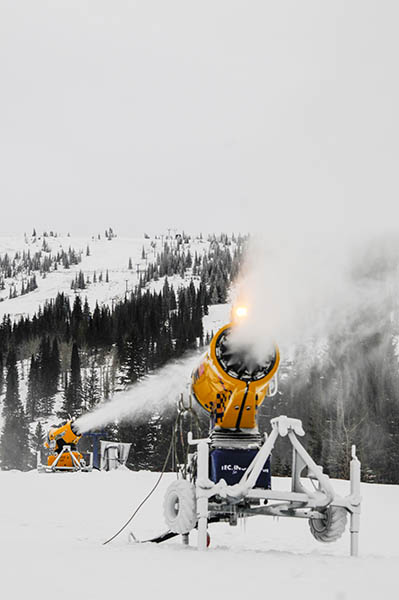 Photo of snowmakers blowing out wet snow at Schweitzer.