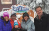 Photo of OTO publishers, Shallan & Derrick Knowles with family posing in front of Big White sign.