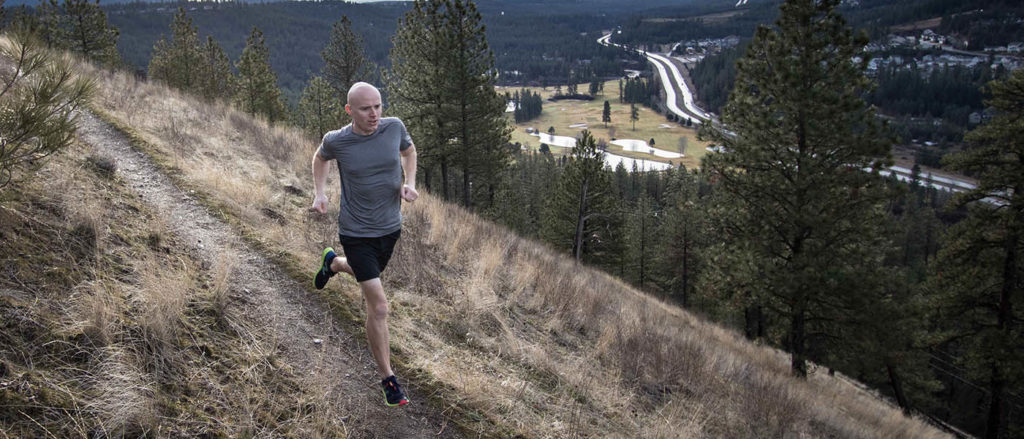 Photo of Peter Hawkins running along the South Hill Bluff.