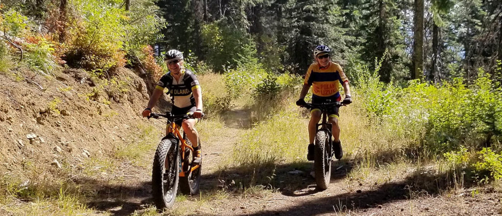 Lisa_Marie Perino and Alex Renner ride fat bikes on Mt. Spokane.
