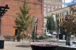 A glass of red wine enjoyed outside in downtown Spokane.