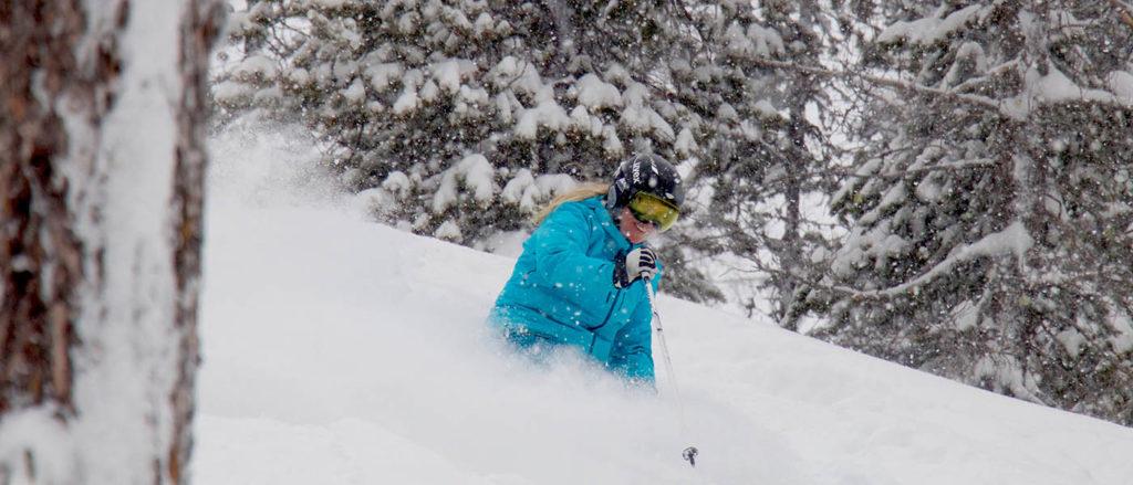 Photo of Kelli Christopherson skiing powder at Lookout Pass.