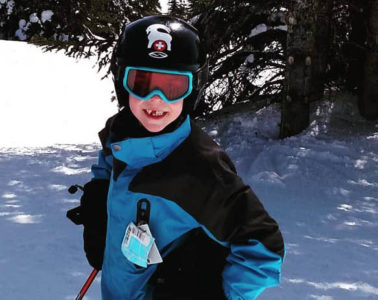Photo of young boy tree skiing.