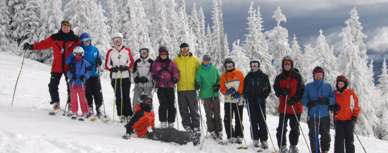 Photo of the entire Fletcher Clan posed on a ski slope at Mt Spokane.