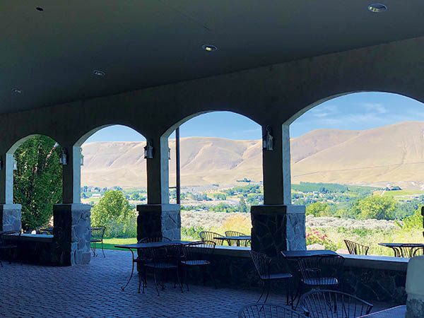 Photo taken from under covered stone patio overlooking Central Washington.