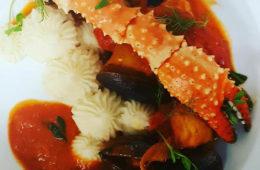 photo of crab leg and pasta.