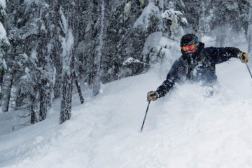 Photo of Bill Fuzak skiing powder.