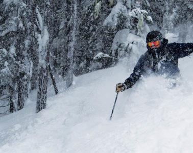 Photo of Bill Fuzak skiing powder.