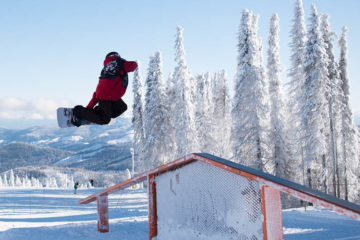 Owen Cline throwing a method grab at Mt. Spokane's Jingle Rails.